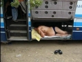Driver sleeping in the baggage compartment