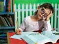 Kid pretending she is studing