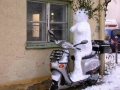 Snowman riding motorcycle
